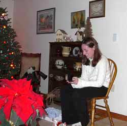 Megan opens a gift from Mother